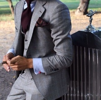 How to wear: grey three piece suit, light blue dress shirt, burgundy tie, burgundy pocket square