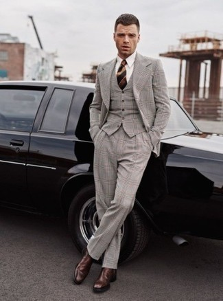 Three Piece Suit Outfits: This getup suggests that it is totally worth investing in such elegant menswear pieces as a three piece suit and a white dress shirt. For footwear, you can stick to the casual route with dark brown leather chelsea boots.