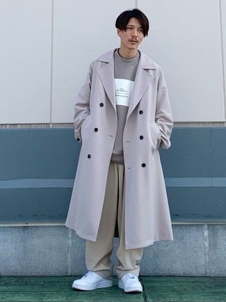 Grey Trenchcoat Outfits For Men: Pair a grey trenchcoat with beige chinos to achieve a neat and classy menswear style. In the shoe department, go for something on the casual end of the spectrum by finishing with white leather low top sneakers.