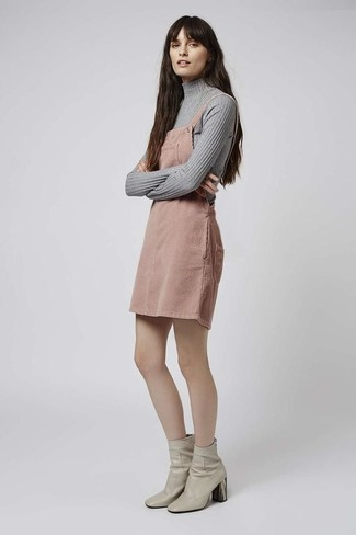 How to wear: grey turtleneck, beige overall dress, grey leather ankle boots