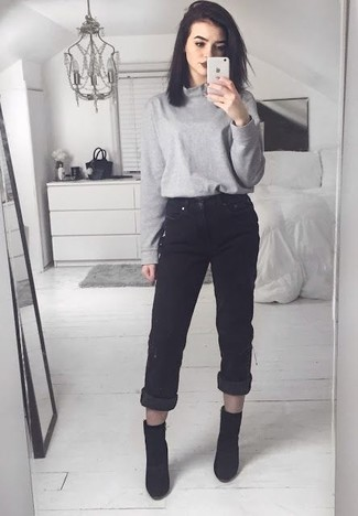 A grey turtleneck and black boyfriend jeans will give off this very sexy and chic vibe. Dress up this look with black booties.