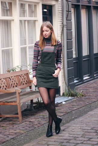 How to wear: grey horizontal striped turtleneck, charcoal denim overall dress, black leather chelsea boots, black tights