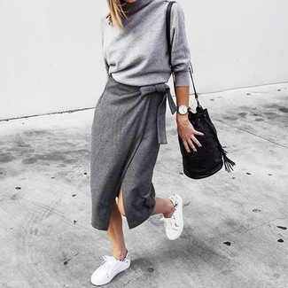 How to wear: grey turtleneck, grey slit midi skirt, white low top sneakers, black leather bucket bag