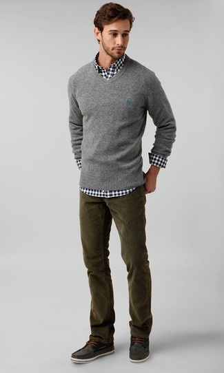 Dress in a grey v-neck sweater and olive green cord jeans for a casual level of dress. Charcoal suede topsiders are a wonderful choice to complete the look.