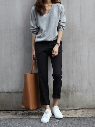 How to wear: grey v-neck sweater, black chinos, white low top sneakers, brown leather tote bag
