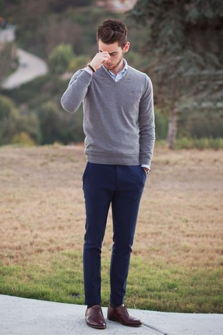A grey v-neck pullover and dark blue casual pants is a great combination to add to your styling repertoire. A cool pair of oxford shoes is an easy way to upgrade your look.