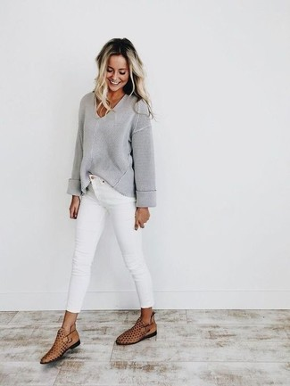 Women's Looks & Outfits: What To Wear In 2020: Go for something casual yet on-trend with a grey v-neck sweater and white skinny jeans. If you wish to effortlesslly step up your look with shoes, complement this getup with tan cutout leather ankle boots.