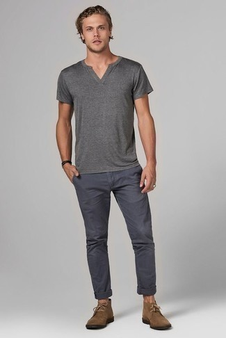 How to Wear a Grey V-neck T-shirt For Men: For a casually cool look, try teaming a grey v-neck t-shirt with charcoal chinos — these items work nicely together. A trendy pair of brown suede desert boots is an effective way to power up this getup.