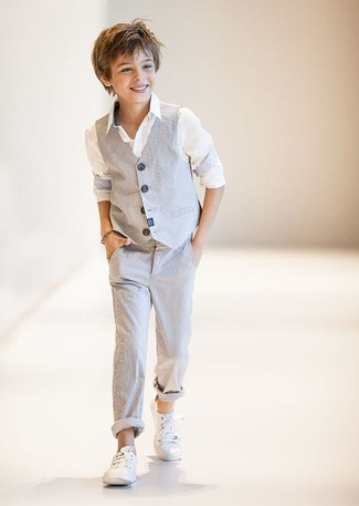How to wear: grey waistcoat, white long sleeve shirt, grey trousers, white sneakers