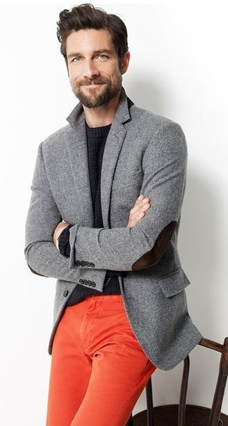 Wear a grey wool blazer with red chino pants for a seriously stylish look.