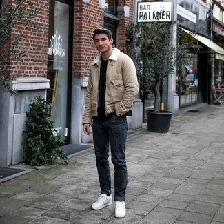 Charcoal Jeans Outfits For Men: You're looking at the irrefutable proof that a beige harrington jacket and charcoal jeans look awesome when teamed together in a relaxed casual getup. Our favorite of a myriad of ways to finish off this ensemble is with a pair of white leather low top sneakers.