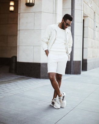 500+ Casual Outfits For Men: A white harrington jacket and white shorts worn together are a sartorial dream for those who love laid-back combinations. Give a carefree feel to your ensemble by slipping into a pair of beige athletic shoes.