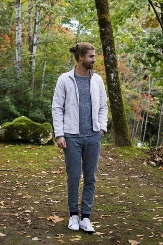 Sweater Outfits For Men: Want to infuse your menswear collection with some elegant cool? Go for a sweater and blue chinos. Complement your look with a pair of white canvas low top sneakers to immediately boost the wow factor of any look.