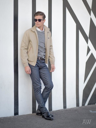 How to wear: beige harrington jacket, grey crew-neck sweater, white long sleeve shirt, navy jeans