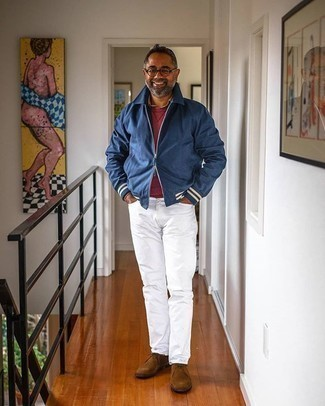 White Jeans Outfits For Men: Extremely dapper, this casual combination of a blue harrington jacket and white jeans will provide you with amazing styling possibilities. Add a pair of brown suede desert boots to your outfit et voila, this ensemble is complete.