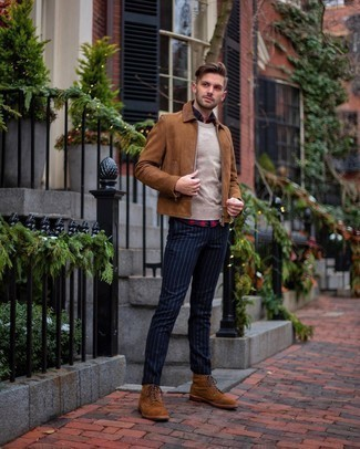 Beige Crew-neck Sweater Fall Outfits For Men: Pairing a beige crew-neck sweater and navy vertical striped chinos will prove your skills in men's fashion even on dress-down days. Go ahead and introduce brown suede casual boots to the mix for an extra touch of polish. When it comes to dressing for autumn, nothing beats a knockout combo that transitions easily between seasons.