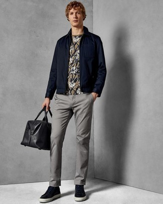 How to Wear a Navy Harrington Jacket: This combination of a navy harrington jacket and grey chinos is super easy to do and so comfortable to work as well! For something more on the cool and casual side to complete this ensemble, add a pair of navy leather low top sneakers to this outfit.