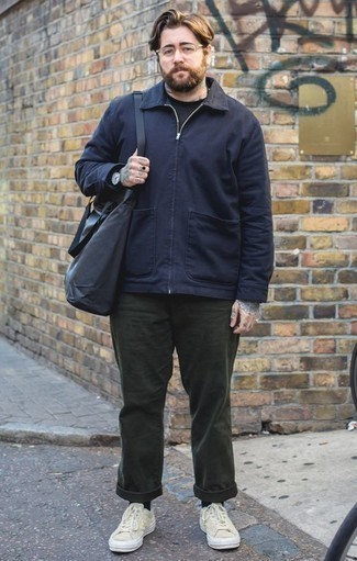 How to Wear Black Socks In Your 30s For Men: This pairing of a navy harrington jacket and black socks is proof that a safe off-duty getup doesn't have to be boring. If you wish to immediately up the ante of your ensemble with shoes, complement this look with beige canvas low top sneakers.