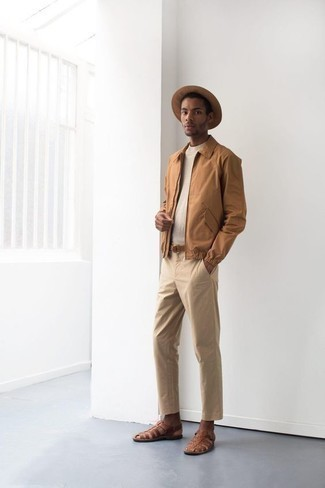 How to Wear a Beige Crew-neck T-shirt For Men: This combination of a beige crew-neck t-shirt and khaki chinos is effortless, sharp and super easy to imitate. You could perhaps get a little creative when it comes to shoes and tone down this look by finishing off with brown leather sandals.