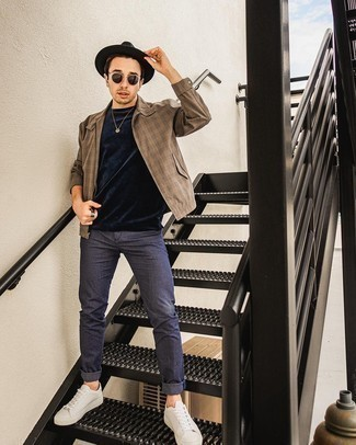 Navy Chinos Outfits: If you're planning for a sartorial situation where comfort is imperative, consider teaming a brown gingham harrington jacket with navy chinos. If in doubt as to what to wear when it comes to shoes, stick to white leather low top sneakers.