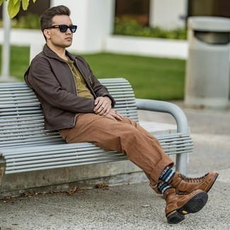 Brown Chinos Outfits: Try teaming a dark brown leather harrington jacket with brown chinos for a casually stylish and trendy outfit. Finishing off with brown leather casual boots is the most effective way to introduce some extra fanciness to your getup.