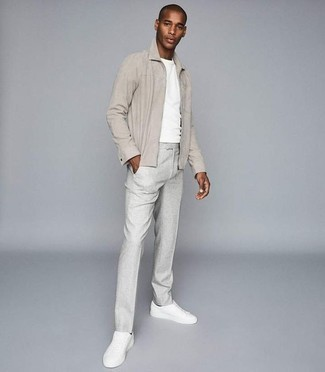 How to Wear a Beige Harrington Jacket: This combo of a beige harrington jacket and grey dress pants is the picture of rugged refinement. Feeling transgressive today? Switch up this outfit by slipping into white leather low top sneakers.