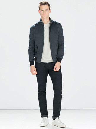 How to wear: charcoal harrington jacket, grey crew-neck t-shirt, black jeans, white leather low top sneakers