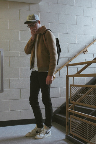 Black Skinny Jeans Outfits For Men: You'll be amazed at how super easy it is for any gentleman to get dressed like this. Just a tan wool harrington jacket worn with black skinny jeans. A cool pair of white and black leather high top sneakers is an easy way to infuse a dose of stylish effortlessness into this outfit.