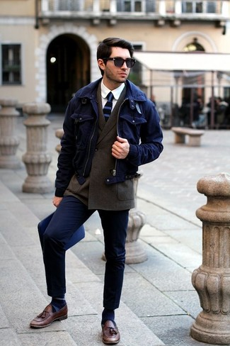 How to Wear a Navy Harrington Jacket: Putting together a navy harrington jacket with navy chinos is an on-point choice for a laid-back but stylish getup. Infuse this look with a touch of polish by wearing a pair of brown leather tassel loafers.