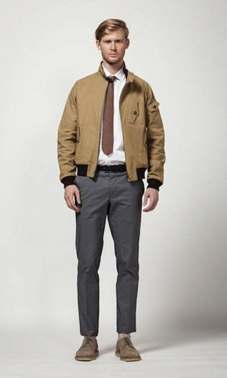 Men's Looks & Outfits: What To Wear In 2020: Team a tan harrington jacket with charcoal chinos for a seriously stylish, off-duty getup. Want to go all out on the shoe front? Complete this outfit with brown suede derby shoes.