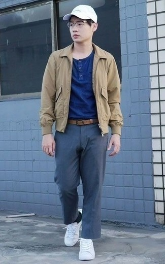 How to Wear a Tan Harrington Jacket: Putting together a tan harrington jacket with navy chinos is a nice pick for a laid-back yet on-trend outfit. For a truly modern hi/low mix, throw a pair of white canvas low top sneakers in the mix.