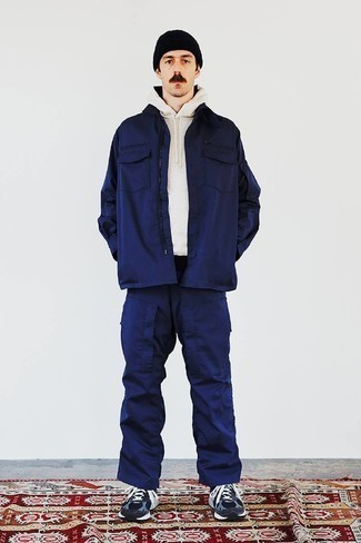 Navy Harrington Jacket Outfits: This laid-back combo of a navy harrington jacket and navy cargo pants is a surefire option when you need to look laid-back and cool in a flash. Clueless about how to finish off? Complement this outfit with navy athletic shoes to change things up a bit.