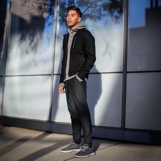 How to Wear a Grey Hoodie For Men: A grey hoodie and charcoal chinos matched together are a perfect match. Complement this ensemble with a pair of grey athletic shoes to jazz things up.