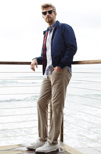 How to wear: navy harrington jacket, white and navy plaid long sleeve shirt, beige chinos, white leather low top sneakers