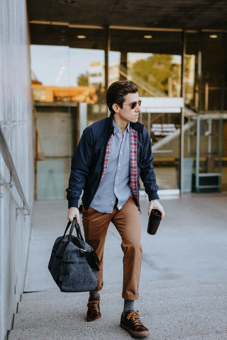 How to Wear a Navy Harrington Jacket: This casual combination of a navy harrington jacket and brown chinos is very easy to pull together without a second thought, helping you look awesome and prepared for anything without spending too much time searching through your wardrobe. Why not introduce a pair of dark brown leather low top sneakers to the mix for a more laid-back twist?