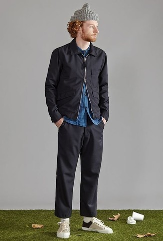 How to Wear Beige Canvas Low Top Sneakers For Men: This combo of a black harrington jacket and black chinos is simple, seriously stylish and very easy to imitate. For an on-trend mix, complete your outfit with a pair of beige canvas low top sneakers.