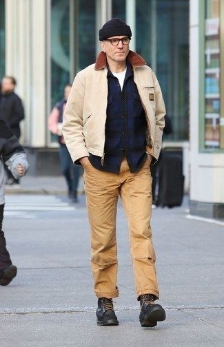 How to Wear a Beige Harrington Jacket: Effortlessly blurring the line between cool and relaxed casual, this combo of a beige harrington jacket and khaki chinos is sure to become one of your favorites. With shoes, go for something on the smarter end of the spectrum by sporting a pair of black leather casual boots.