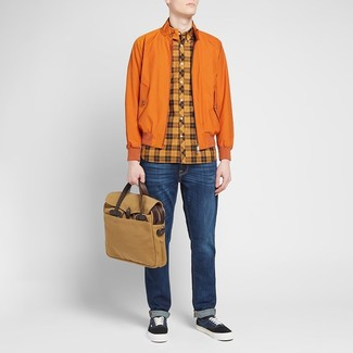 Men's Looks & Outfits: What To Wear In 2020: For something on the casual and cool side, dress in an orange harrington jacket and navy jeans. Navy canvas low top sneakers look amazing here.