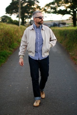 How to Wear a Beige Harrington Jacket: This combo of a beige harrington jacket and navy jeans is definitive proof that a straightforward casual ensemble doesn't have to be boring. If in doubt about what to wear on the shoe front, go with tan leather low top sneakers.
