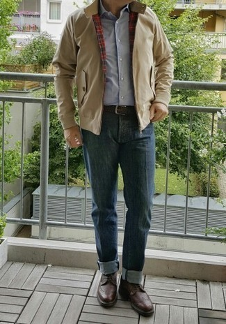 Light Blue Long Sleeve Shirt Outfits For Men: If you feel more confident in practical clothes, you'll like this seriously stylish combo of a light blue long sleeve shirt and blue jeans. Feeling transgressive today? Spice things up by slipping into dark brown leather brogues.