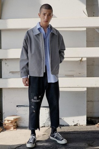 Men's Outfits 2020: A grey harrington jacket and black print jeans are a great getup to have in your daily casual wardrobe. We're totally digging how complete this outfit looks when complemented by a pair of black and white canvas low top sneakers.