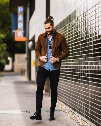 How to Wear a Blue Chambray Long Sleeve Shirt For Men: This off-duty combination of a blue chambray long sleeve shirt and black skinny jeans is extremely easy to pull together without a second thought, helping you look dapper and prepared for anything without spending a ton of time combing through your closet. Black leather casual boots are the most effective way to infuse an extra touch of style into this ensemble.