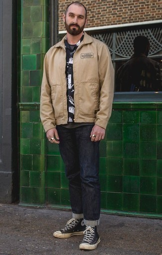 How to Wear a Tan Harrington Jacket: A tan harrington jacket and navy jeans are the kind of a no-brainer off-duty getup that you need when you have zero time to spare. Complete this look with a pair of navy and white canvas high top sneakers to instantly ramp up the cool of this ensemble.