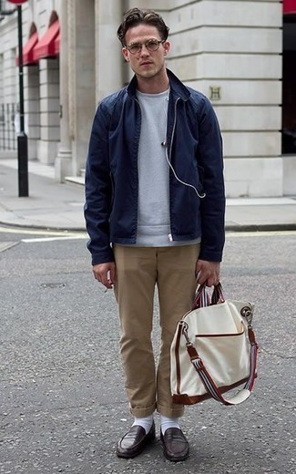 How to Wear a White Canvas Tote Bag For Men: If you're hunting for a bold casual and at the same time on-trend look, make a navy harrington jacket and a white canvas tote bag your outfit choice. Dial up your look by slipping into dark brown leather loafers.