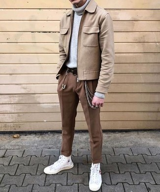 How to Wear a Belt For Men: Definitive proof that a tan wool harrington jacket and a belt are awesome when paired together in a relaxed casual look. For a more polished touch, why not complement this ensemble with white canvas high top sneakers?