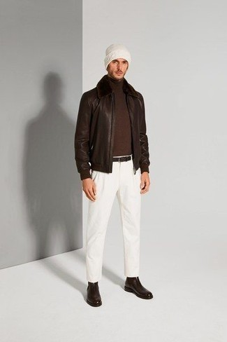 Harrington Jacket Outfits: Consider wearing a harrington jacket and white chinos to showcase you've got serious menswear prowess. If you need to easily dial up this outfit with one single item, introduce dark brown leather chelsea boots to the mix.