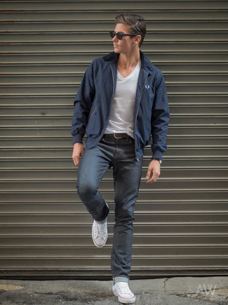 How to wear: navy harrington jacket, white v-neck t-shirt, charcoal jeans, white canvas low top sneakers