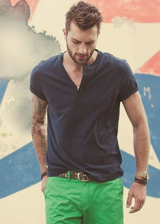 Consider pairing a charcoal henley shirt with green chino pants for a refined yet off-duty ensemble.