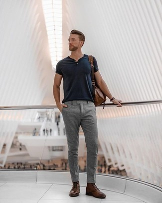 How to Wear a Brown Leather Backpack For Men: Why not dress in a navy henley shirt and a brown leather backpack? As well as super practical, both of these items look amazing when teamed together. With shoes, you can take the classic route with brown leather casual boots.