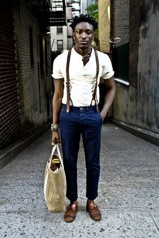 Beige Canvas Tote Bag Outfits For Men: This modern casual pairing of a white henley shirt and a beige canvas tote bag is very versatile and up for whatever adventure you may find yourself on. In the shoe department, go for something on the dressier end of the spectrum with brown leather monks.